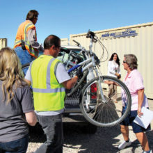 Bicycles being unloaded for donation; photo by Diane Quinn