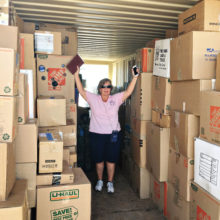 Laura Colbert, event chairperson, surrounded by some of the items delivered to the VA; photo by Jerry Colbert