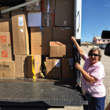 Event Chairperson Laura Colbert presents a truckload of donations to the VA; photo by Jerry Colbert