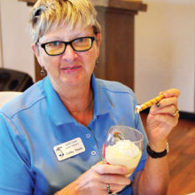 Putters President Cathy Thiele enjoys a strawberry parfait on her birthday; photo by Sylvia Butler