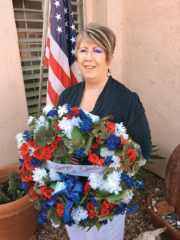 Carol Mutter prepares to attend Veterans Day Wreath Laying Ceremony; photo by Doug Mutter