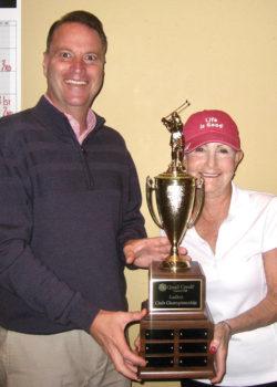 Quail Creek Ladies' Golf Association 18-Hole Club Champion Kathy Brennan with Joel Jaress