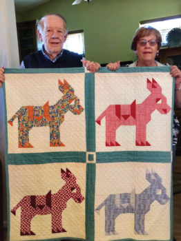 Gordon and Becky Gray with Gordon's vintage quilt