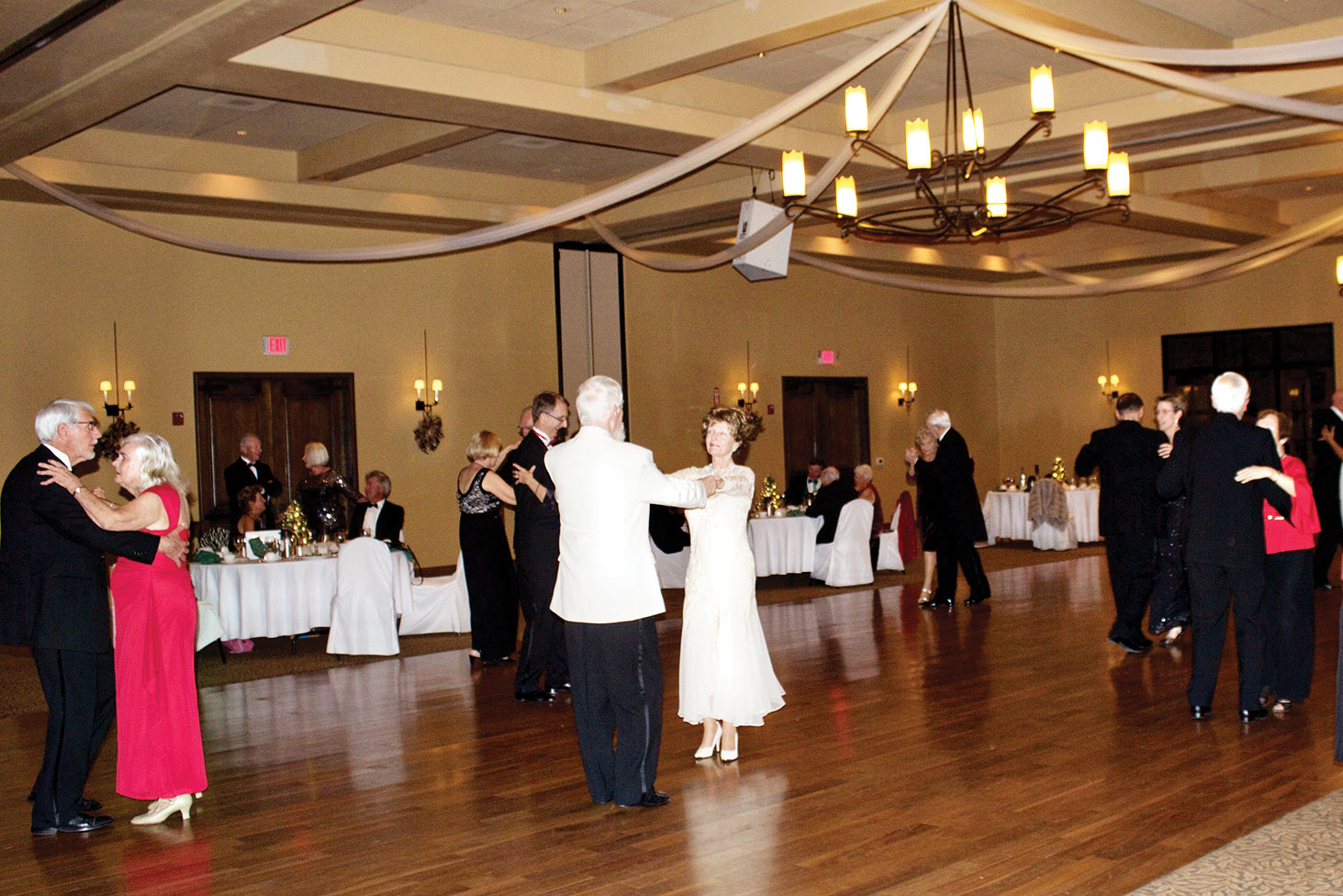 Ballroom Dance Club members George and Ona Gibson and Jack and Wendy Berry enjoy dancing at the December dinner.