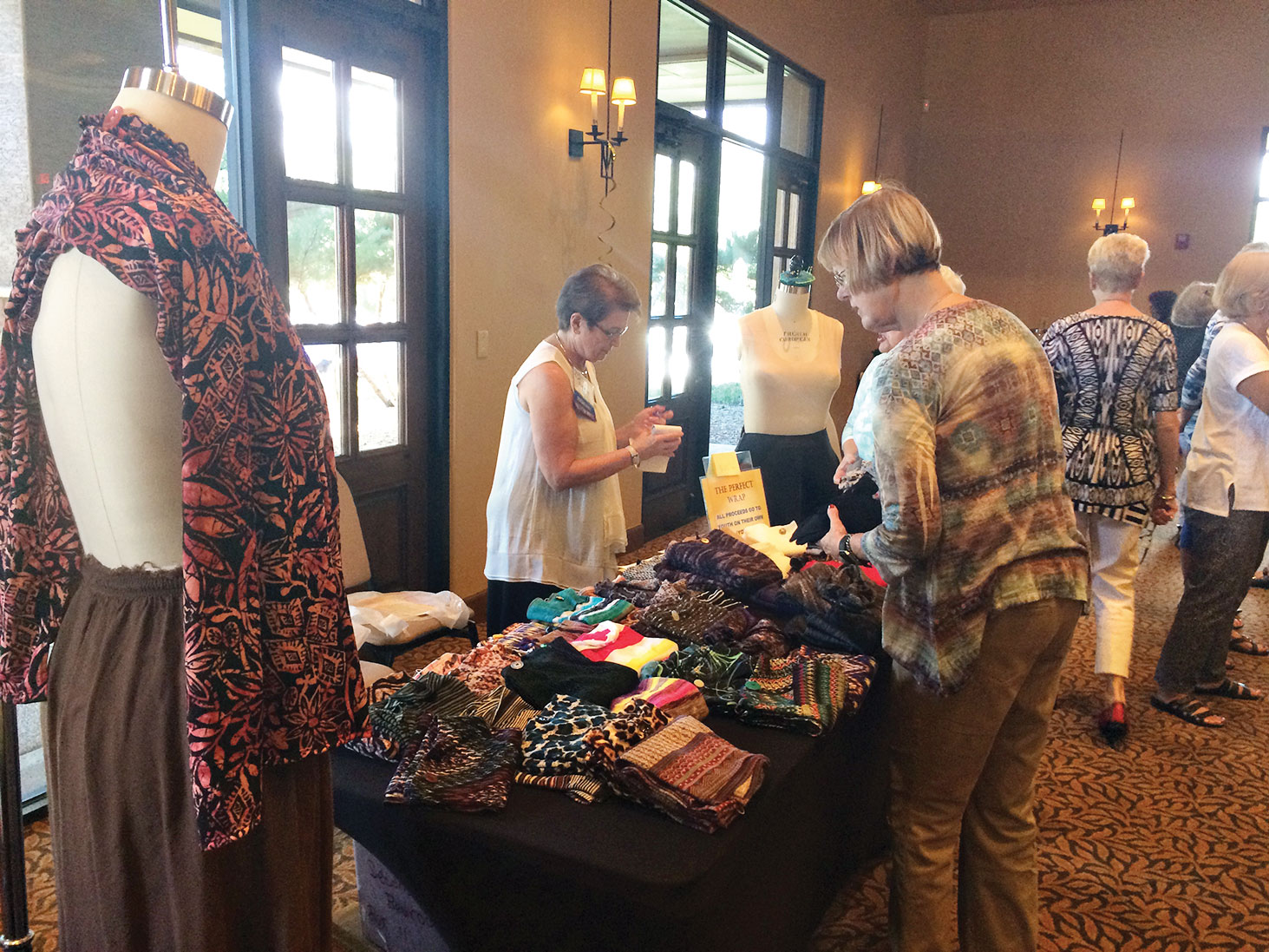 SueAnn Obremski selling Perfect Wraps during the TWOQC Membership Brunch; photo by Marianne Cobarrubias