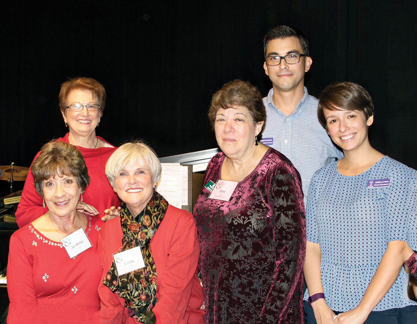TWOQC volunteers, left to right: Jo-Anne Spencer, SueAnn Obremski, Cindy Hogg and Jane Gold with YOTO representatives Daniel Armenta and Kristyn Conner; photo by Eileen Sykora