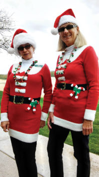 Lady Putters Diane Dodd and Mary Anderson were decked out as Santa's helpers (or Santas in training) when they putted right before Christmas; photo by Sylvia Butler