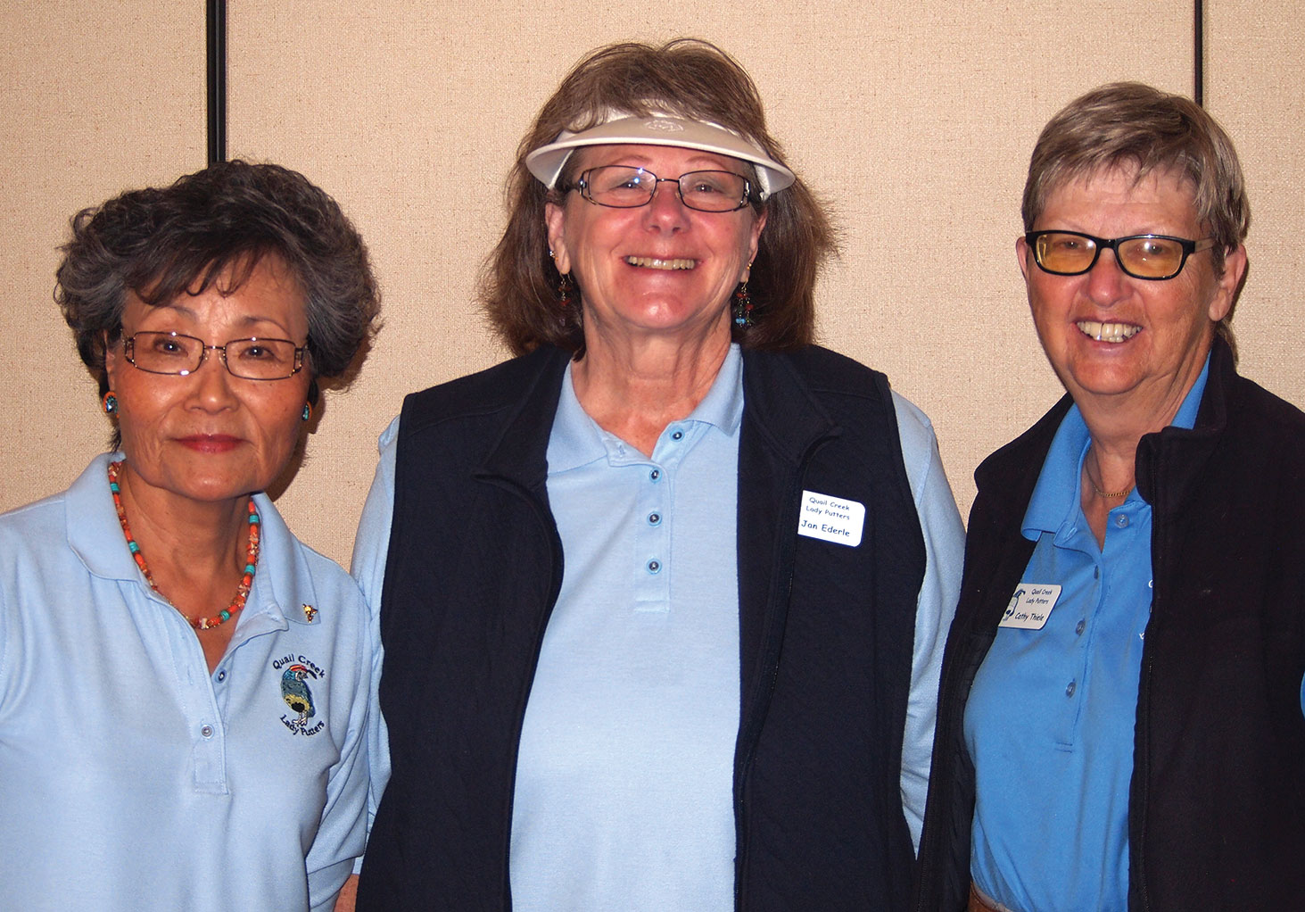 Left to right: Yoshie Hennessey celebrates 57 holes-in-one, Jan Ederle for maintaining the lowest net score, as Cathy Thiele congratulates them for their 2016 achievements; photo by Sylvia Butler.