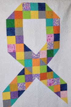 A quilt made especially for this event and awarded through the silent auction; photo by Eileen Sykora