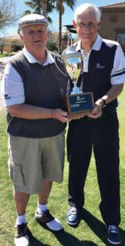 Tim Phillips, president of the QCMGA, presents the President's Cup trophy to the 2017 winner - Paul Athey