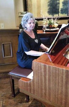 Pianist Cyndy Gierada played a variety of patriotic music during the event; photo by Betty Atwater.