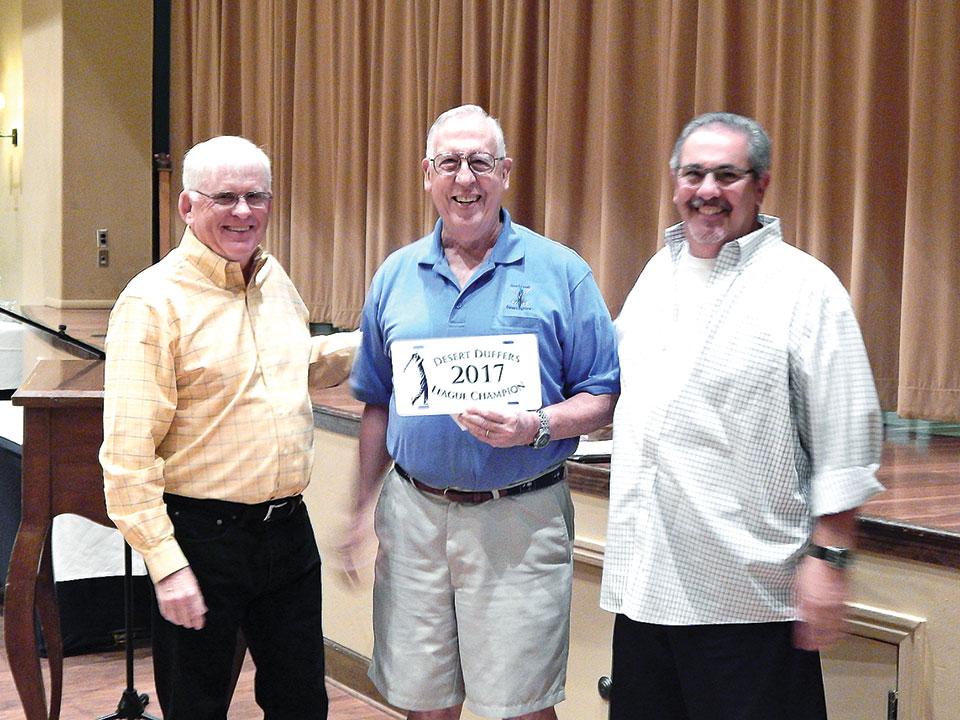 President Russ Sipe and Vice President Ed Pope present the 2017 Desert Duffer Golf Championship award to David Martinson.