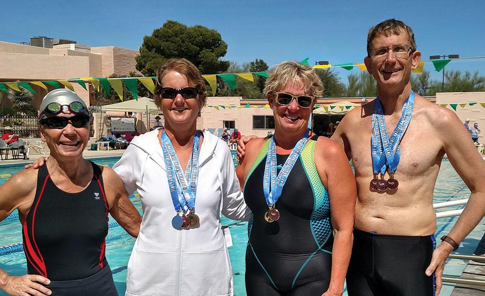 Left to right: Deborah Dunipace, Kathy Stacken, Coach Joannie Eastridge, Steve Huhta