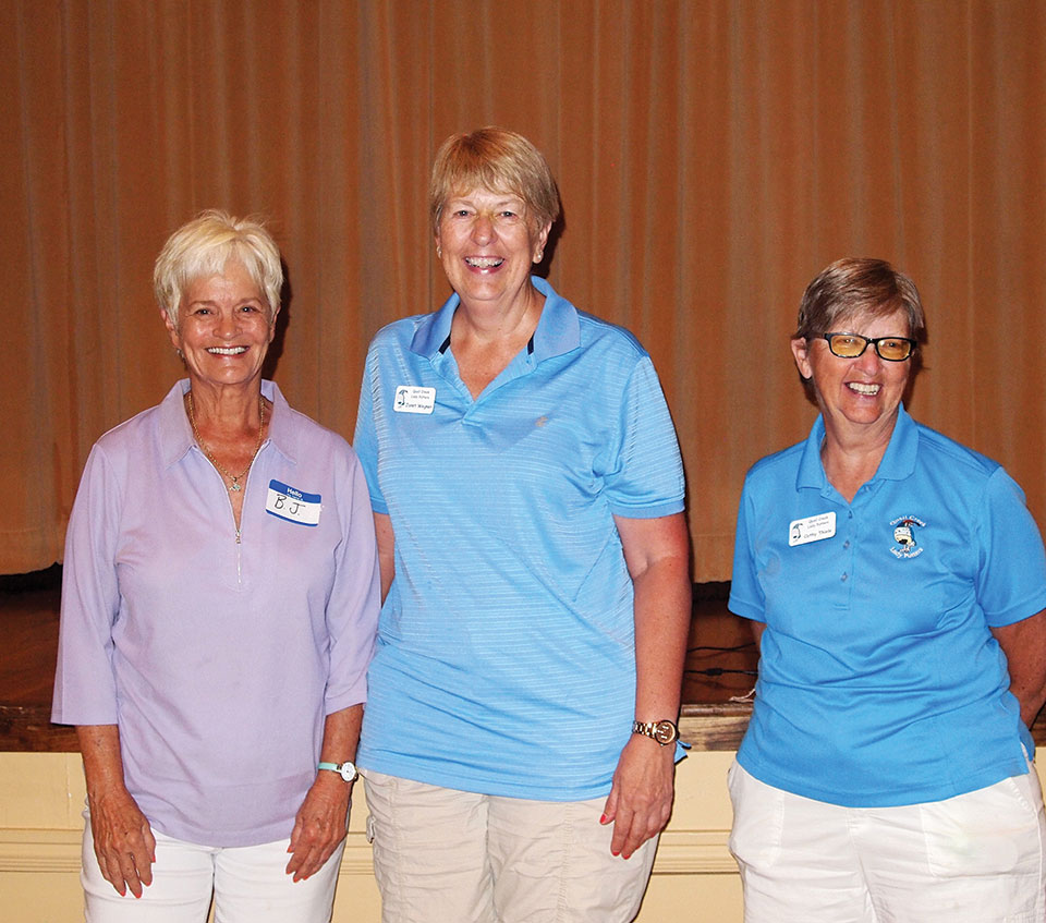 Left to right: BJ Hanks and Janet Wegner are congratulated by Cathy Thiele for putting under 36 for the first time; photo by Sylvia Butler.