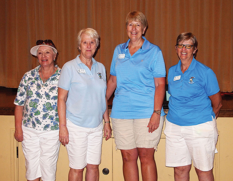 Left to right: Hole-in-One winners included Frieda Hyles, Peggy Brown, and Janet Wegner who are congratulated by Cathy Thiele; photo by Sylvia Butler.