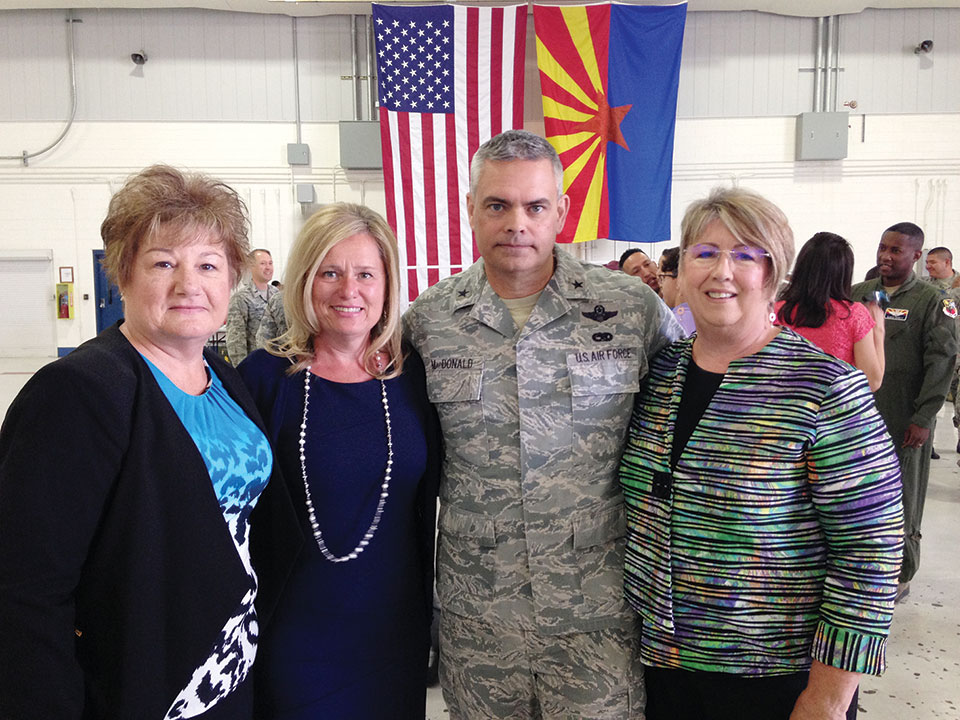 From left: TWOQC baby shower Chair Pam Rodgers, Mrs. Roslyn MacDonald, Brigadier General MacDonald and TWOQC President Carol Mutter