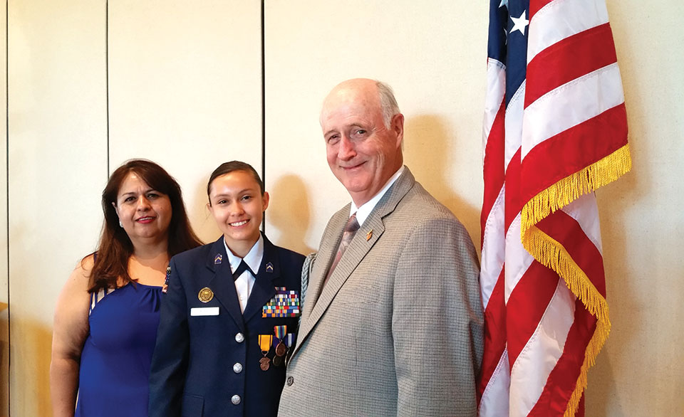 Cadet Major Ana Fajardo, Air Force JROTC, is flanked by her mother Sonia Corrazco and Lieutenant Colonel Don Belche, JROTC Advisor at Nogales Hugh School; photo by Betty Atwater.