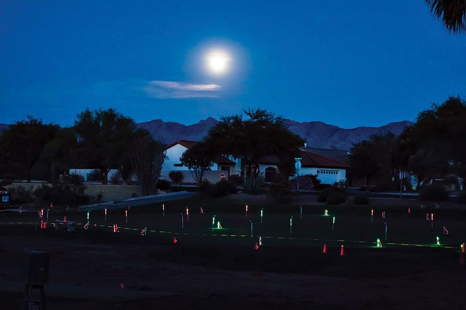 The full moon shown over the putting green; photo by Jim Burkstrand.
