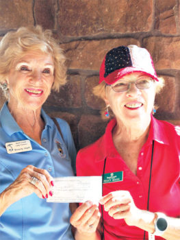 Left to right: Beverly Hiatt is all smiles as she is presented a check for $168.50 by MOAA Treasurer Peggy McGee. Bev donated a portion of her 50-50 raffle winnings to the Military Assistance Fund; photo by Jenny McGinnis