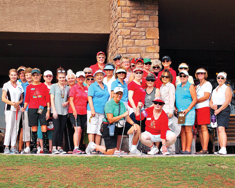 The Lady Putters wore holiday colors for the annual Christmas in July event; photo by Sylvia Butler