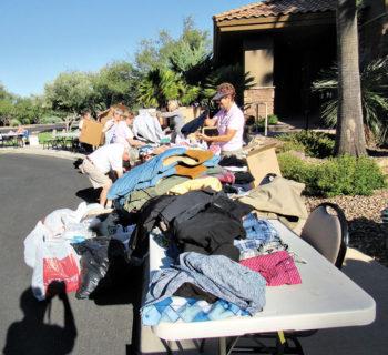 Volunteers sort men's clothing during last year's drive. Photo by Eileen Sykora