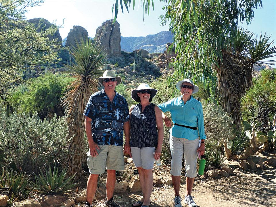 Cooper and Celeste Eastman and Barb Giudici hiking the main trail
