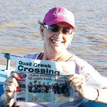 Joyce Shumate relaxed at Lake Chapala, Mexico (the largest lake) along with her copy of the Crossing.