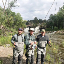Rocky Mountain High fly fishing for Andy Bandstra along with son and grandson over Father's Day weekend found them reading the Crossing.