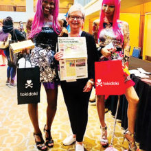Diana VanRossum just couldn't resist the Barbie Convention photo-op. What a fun and colorful adventure!