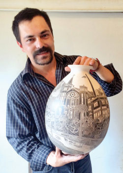 Hector Javier Martinez with one of his sgraffito pieces.