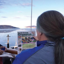 Quail Creek resident Terra was caught reading the Crossing in front of the Eqip Sermia Glacier in Western Greenland this summer while on a Road Scholar trip to Greenland and Iceland.