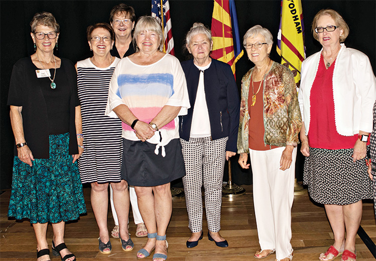 Representing the charitable committees (from left): Pat Neel, TWOQC president; Sue Ann Obremski, Military Baby Shower; Diane Quinn, YOTO; Suzan Bryceland, Scholarship; Nancy Jacobs, Fashion Show for Cancer Relay for Life; Peggy McGee, Honor flight/VA Support; and Tessie Hagerich, VA Homeless Veterans Clothing Drive.