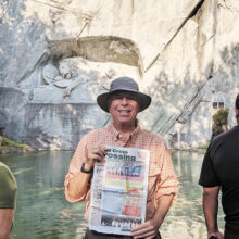 Jeff Prager reads the Crossing while visiting Lion Monument in Lucerne, Switzerland.
