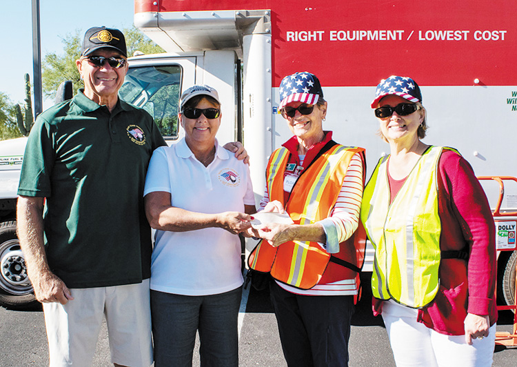 From left: Al and Kathy Olbeter, Quail Creek Veterans Golf Association charity chairpersons; Pat Neel, TWOQC president; and Tessie Hagerich, TWOQC VA Clothing Drive chairperson.