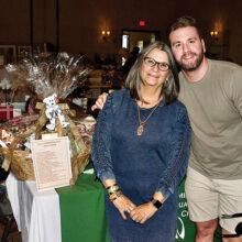 """Scholarship's """"Chocolate! Chocolate!"""" basket winner Patty Bragg and her nephew Jake MacLean."""