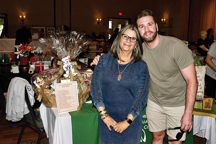 "Scholarship's ""Chocolate! Chocolate!"" basket winner Patty Bragg and her nephew Jake MacLean."