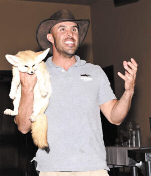 Jed Dodds holding a fox.