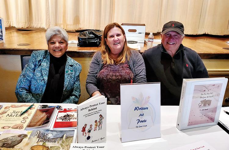 President Paul Riggins, with authors Barbara Ayers and Yasmin John-Thorpe.