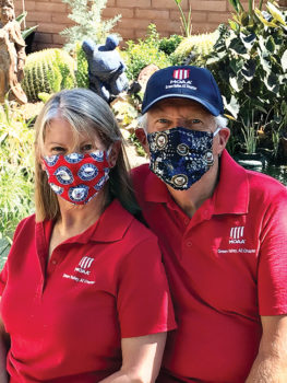 MOAA members Myra and Jeff McCune, both U.S. Navy retirees, model the masks in the two different patterns available for the Navy. (Photo by Bruce Hilt)