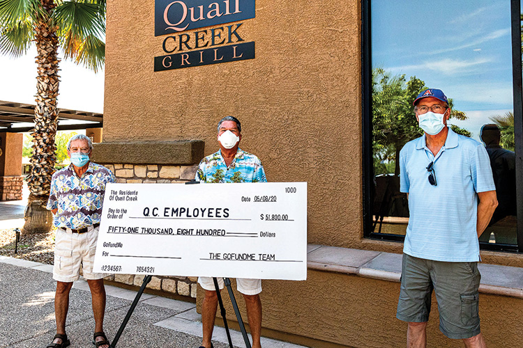 QC GFM team members Harvey Trott, Andrew Rodriguez, and Jon Quinn (left to right) reveal the ceremonial check presented to QC management.