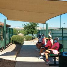 Residents enjoying the new sun shade.