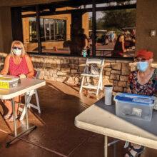 Sign in table: (left) Deb Riddell, tournament chair (right) Sandi Hrovatin, treasurer