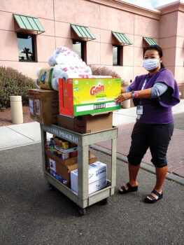 One of the dozen VA staff who helped unload the vehicles. (Photo by Peggy McGee)