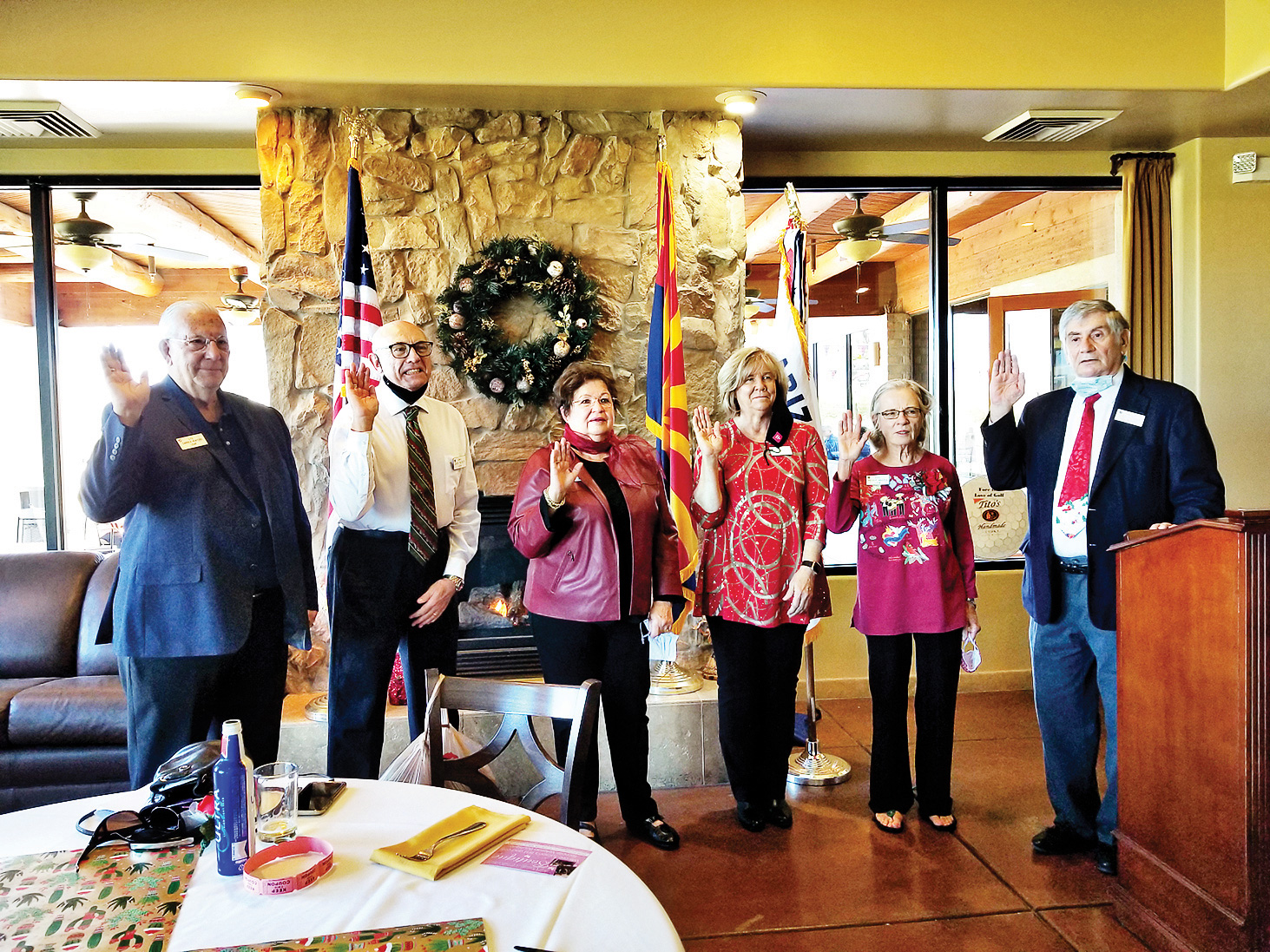 New board members (left to right) Darren Venters, Jack Bundy, Nora Durham, Jadine Hilt, Peggy McGee, and Joe Longo are sworn into office by past president John McGee. (Photo by Betty Atwater)