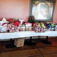 Children and moms received several gifts from MOAA. The rest of the gifts were in the car—too many to carry! (Photo by Betty Atwater)