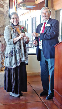 MOAA president Joe Longo presented a check for $250 to Karen Kuciver, founder and CEO of Women Warriors. (Photo by Peggy McGee)