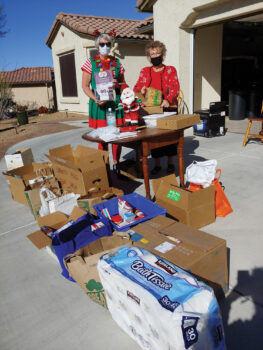 Janet Wegner (left) and Sharon Schoen with some of the donations received on Dec. 16. (Photo by Peggy McGee)