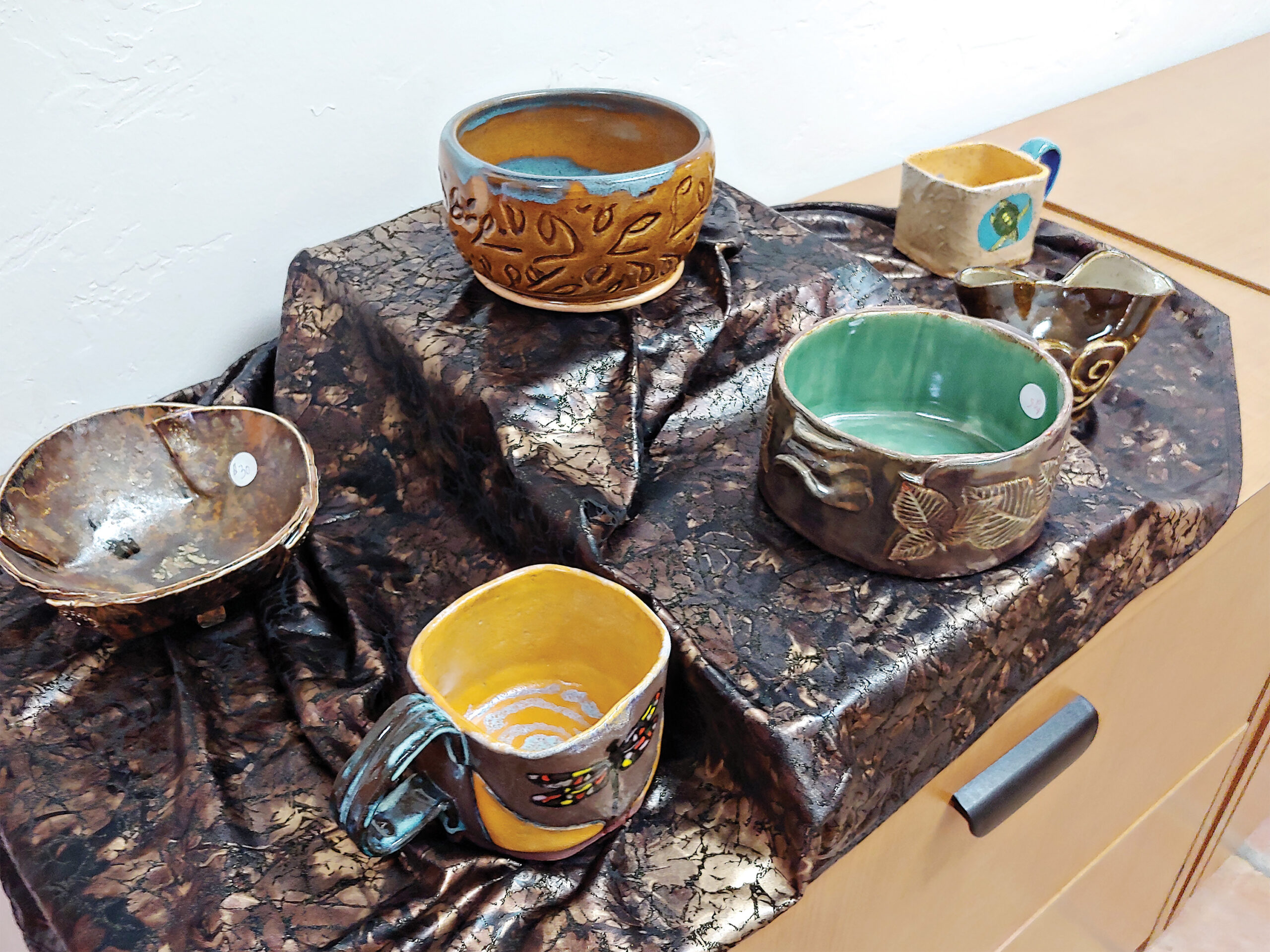 Just a few of the bowls donated by the Quail Creek Ceramics and Pottery & Sculpture Studio clubs. (Photo by Peggy McGee)