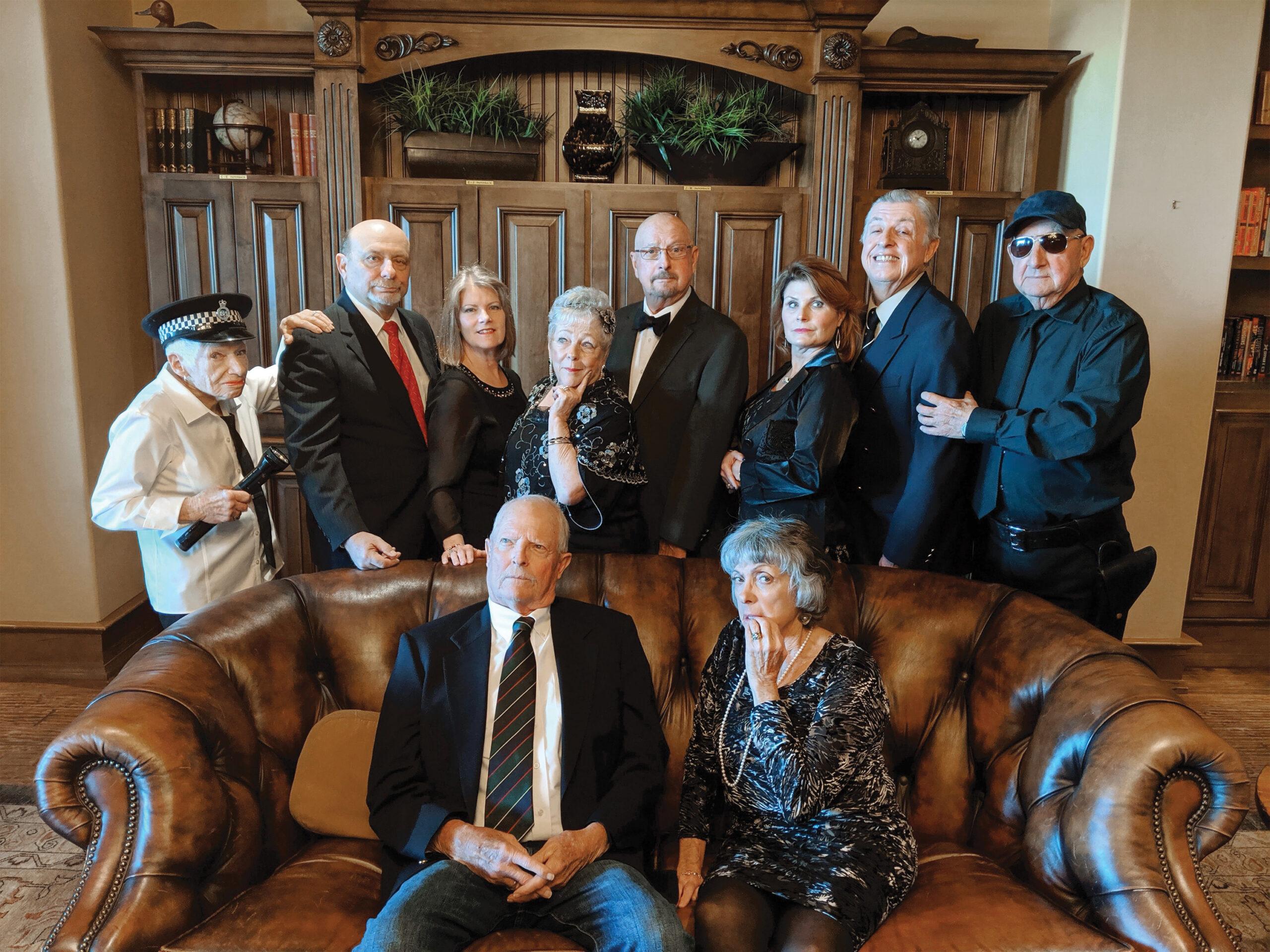 The cast of Rumors standing (left to right): Fay Shapiro, Ray Hebert, Myra McCune, Emilie Ortega, John Martin, Theresa Lewis, Davey Jones, and Ed Radzke; seated: Andy Bailey and Leslie Fellner