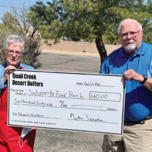 Desert Duffer President Mike Senatra presents a check for $660 to Sue Eaton, Assistant Director at the Sahuarita Food Bank